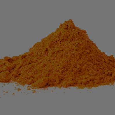 Pharmatechlabs® | Dry Mixing or Dry powder blending of a Orange powder sitting on a white counter.